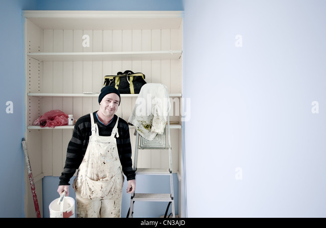 Painter and decorator wearing overalls - Stock Image