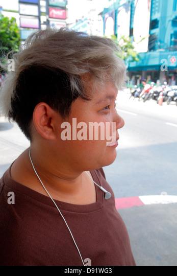 Thailand Bangkok Pathum Wan Siam Square Asian woman dyed hair - Stock Image
