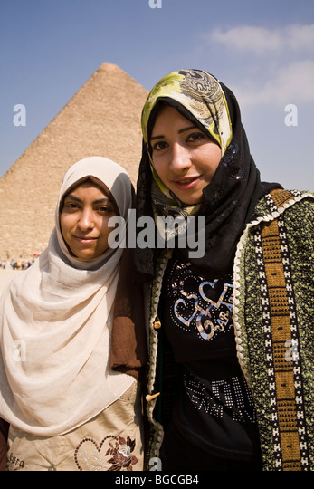 These Moslem high school girls visiting the Pyramids of Giza were most friendly and not at all bashful in font of - Stock Image