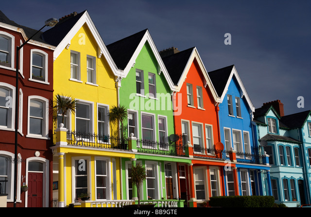 colourful seafront houses at marine parade whitehead county antrim northern ireland uk - Stock Image