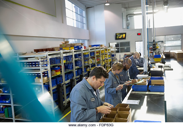 Assembly Line Worker : Assembly line worker stock photos
