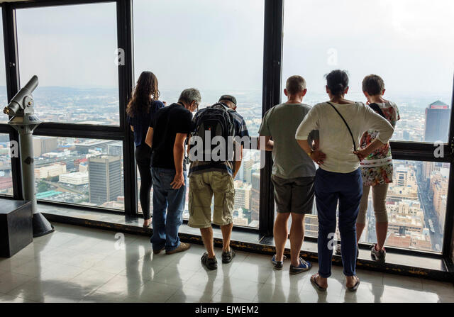 South Africa African Johannesburg Carlton Centre center Top of Africa observatory deck family looking out 126 - Stock Image