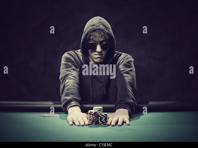 Professional poker player betting everything on one hand - Stock Image