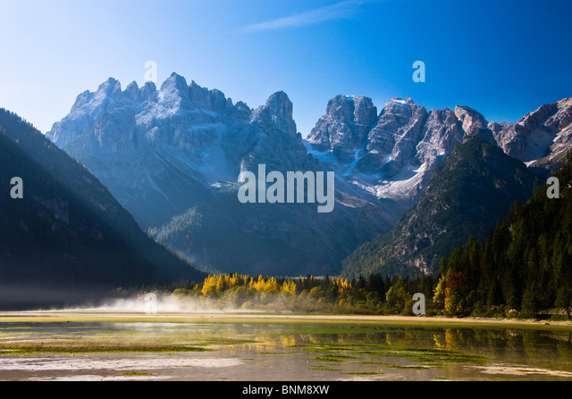 Italy Dolomites Alps Tyrol South Tirol autumn mountains wood forest Landro lake Cristallo holidays travel, - Stock Image