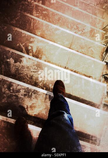 Walking down the stairs - Stock Image