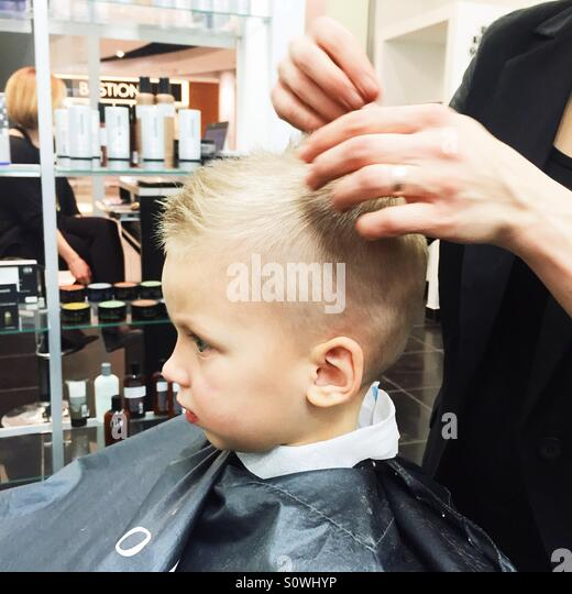 Little boy getting his hairdone - Stock Image