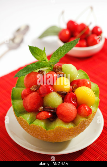Melon with fruit and raisins. Recipe available. - Stock Image