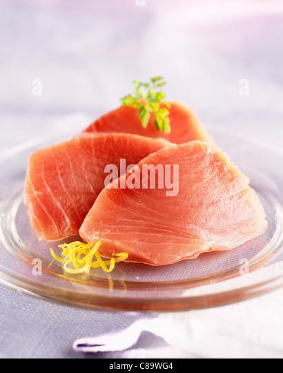 Slices of fresh raw tuna - Stock Image