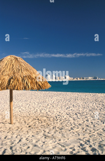 cancun mexico beach caribbean sea palapas thatch sun huts - Stock Image