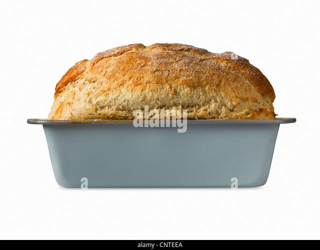 Close up of freshly baked bread in pan - Stock Image