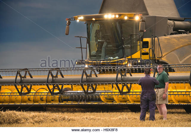 Combine Harvester Stops Work As Storm Approaches - Stock Image