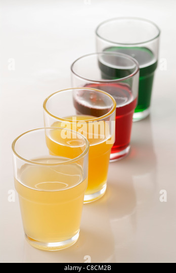 Assorted glasses of syrups - Stock Image