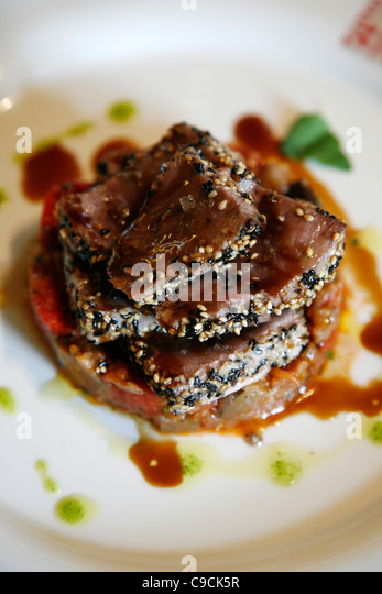 Tuna dish at The upmarket Luigi Pomata restaurant, Cagliari, Sardinia, Italy. - Stock Image