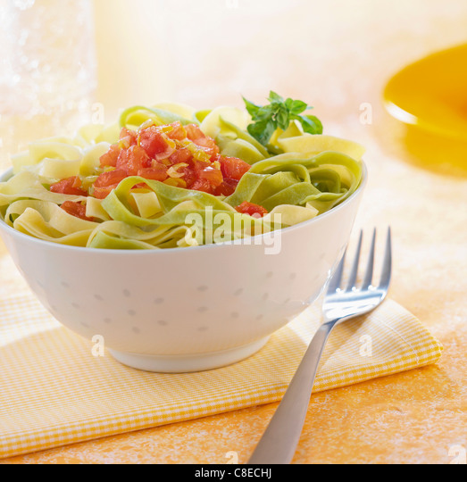 Tagliatelles with leeeks and tomato sauce - Stock Image