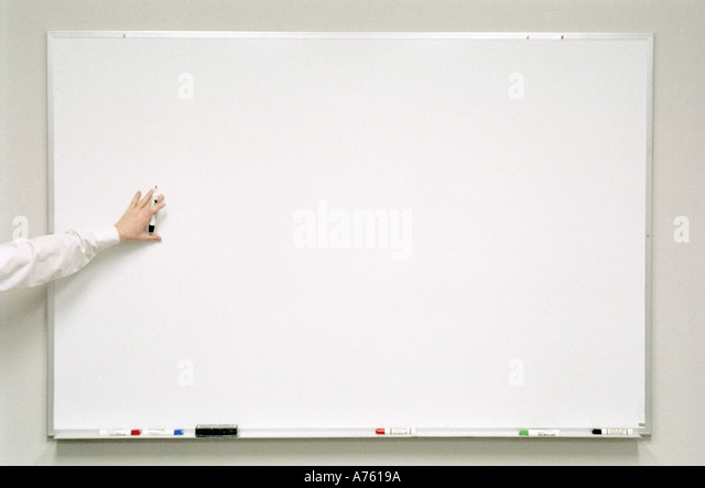 Businessman pointing to whiteboard while giving presentation  - Stock-Bilder