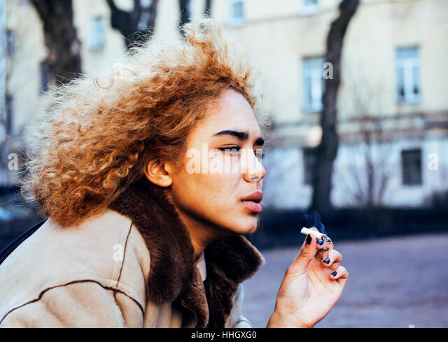 young pretty girl teenage outside smoking cigarette close up, lo - Stock Image
