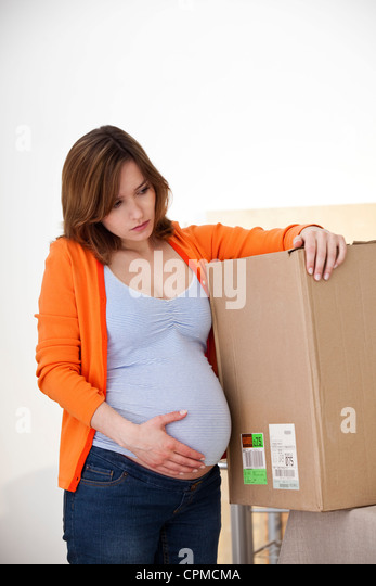 ACTIVE PREGNANT WOMAN INDOORS - Stock Image