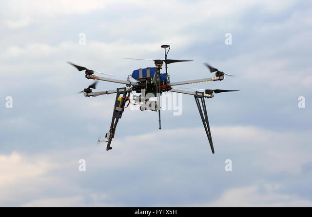 Flying  drone in the sky with mounted  digital camera - Stock Image