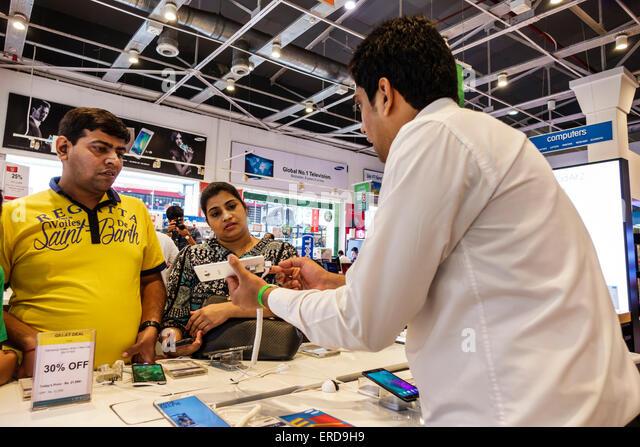 Mumbai India Asian Lower Parel High Street Phoenix mall inside shopping Big Bazaar electronics store sale man salesman - Stock Image
