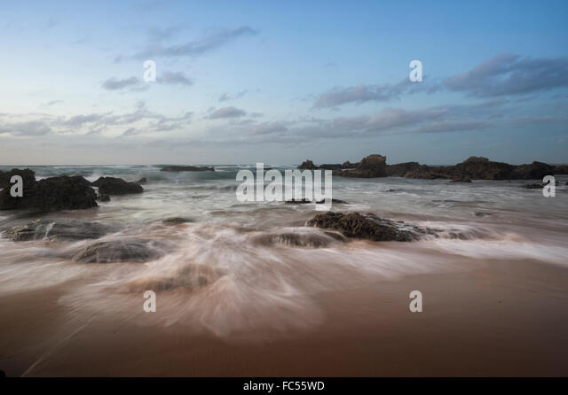 waves on the rocks at Praia do Castelejo - Stock Image