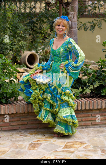 Beautiful blond middle aged Spanish woman in traditional costume, Fuengirola Feria, Andalucia, Spain, Europe - Stock Image