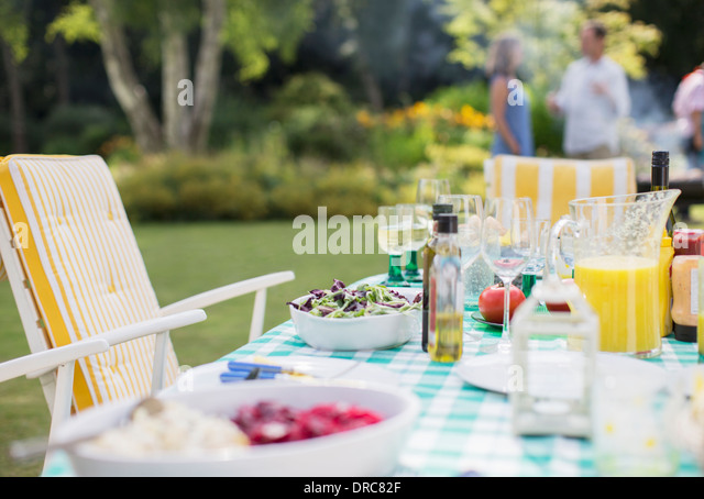 Lunch on table in backyard - Stock Image