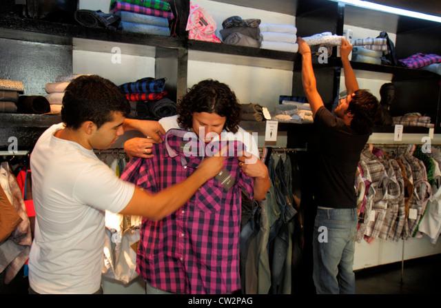 Mendoza Argentina Avenida San Martin shopping store business retail casual wear men's clothes apparel clothing - Stock Image
