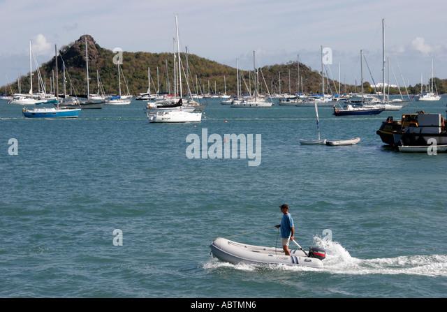 Saint Martin French Simpson Bay Lagoon boats sailboats anchored inflatable dinghy pilot - Stock Image