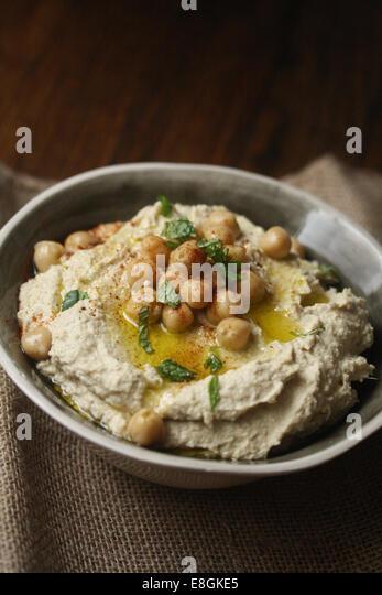 Spicy chipotle hummus on table - Stock-Bilder