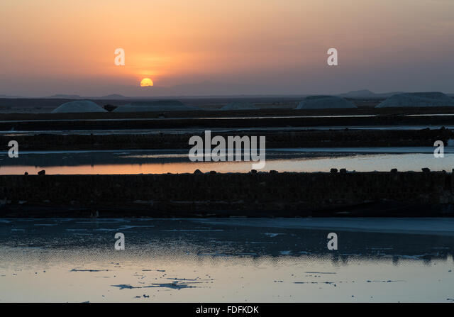 Sunset scenes over the salt drying ponds at Afrera in the Afar Depression of Ethiopia - Stock Image