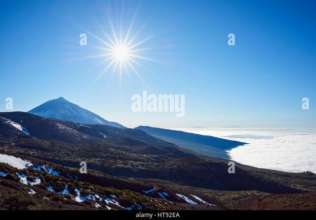 Pico del Teide Mountain with Volcanic Landscape and Sun, Parque Nacional del Teide, Tenerife, Canary Islands, Spain - Stock Image