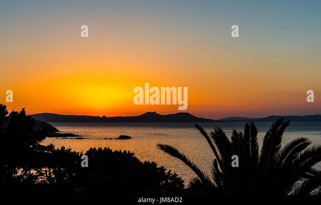 Glorious orange sunset in Sardinia, Italy - Stock Image