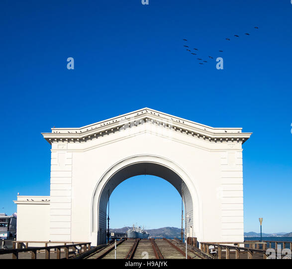 A view of the PIer 43 ferry arch in Fisherman's Wharf, San Francisco, California. The SS Jeremiah O'Brien - Stock Image