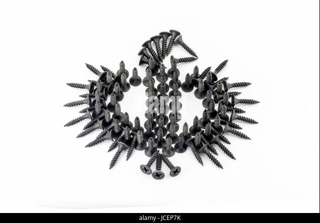 eagle laid out with black Oxidized self-tapping screw isolated on white background - Stock Image