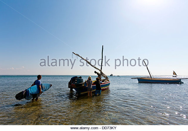 Mozambique, Nampula Province, the island of Mozambique, surfers. - Stock Image