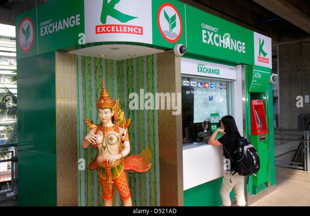Bangkok Thailand Ratchathewi ATM statue exchange money Asian woman customer bank banking - Stock Image