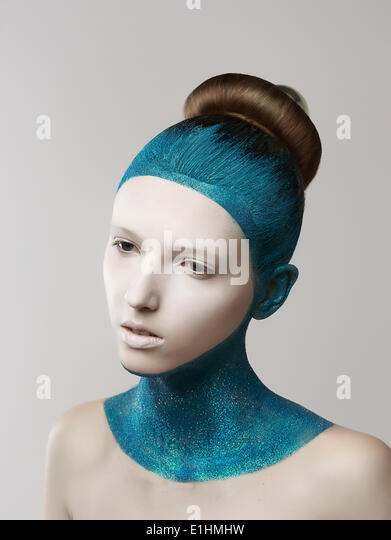 Expression. Fantasy. Eccentric Woman with Blue Painted Skin and Hair. Coloring - Stock Image