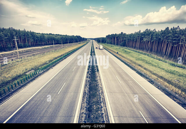 Retro stylized picture of a highway, travel concept. - Stock-Bilder
