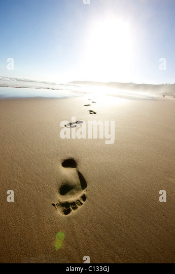 Footprints on beach, Wilderness, Eastern Cape Province, South Africa - Stock Image