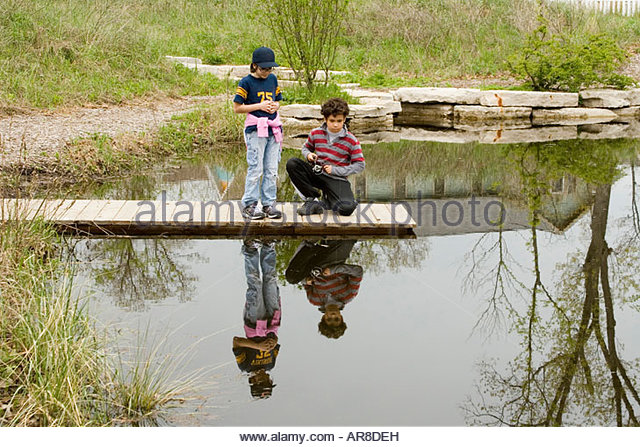 Kids children fishing playing hispanic stock photos kids for Kids fishing net
