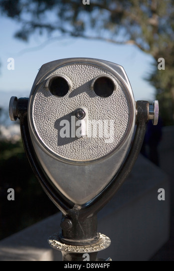 Fixed binoculars at lookout on Telegraph Hill, looking like a face, San Francisco, California - Stock Image