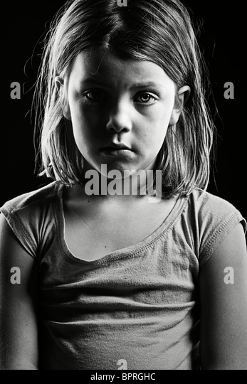 Powerful Black and White Shot of a Sad Looking Child - Stock Image
