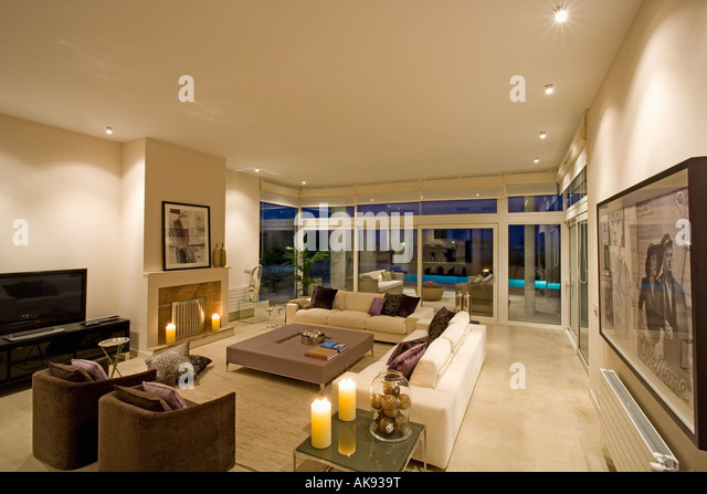 And Cream Sofas In Modern Spanish Living Room With Large Glass Doors