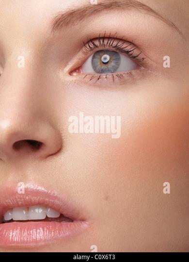 Closeup of a beautiful young woman's face - Stock Image