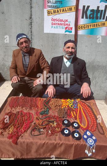 Turkey Istanbul Karakoy Quarter Muslim sidewalk vendors tesbeh beads evil eye protector - Stock Image