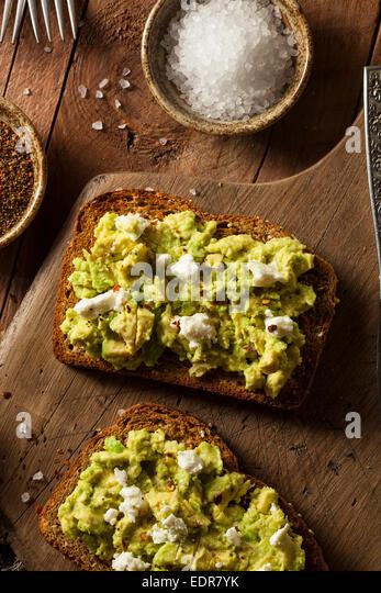 Healthy Homemade Avocado Toast with Salt and Feta - Stock Image