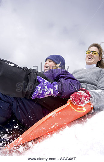 Mother daughter sledding together Cedar Mountain Dixie National Forest Utah Winter - Stock Image