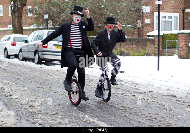 Clowns gather at Holy Trinity Church in Dalston, east London, attending a church service in memory of Joseph Grimaldi. - Stock Image