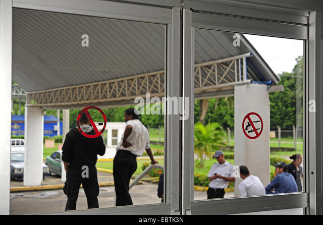 prohibition signs 'weapons forbidden' and 'smoking forbidden' sticking on the window, Honduras, - Stock Image