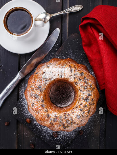 Cake with raisin on a black wooden board - Stock Image